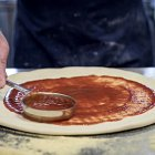 Chef Putting Sauce on Pizza Dough - Food Photography © David Cantwell Photography