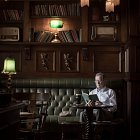 Man Reading a Book With Guiness in a Bar - Food Lifestyle Photography © David Cantwell Photography