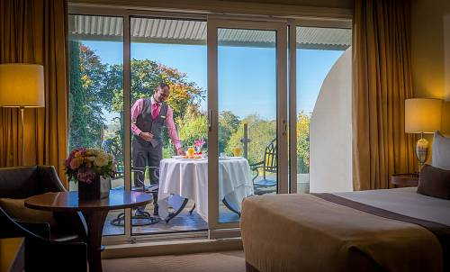 Waiter Setting a Table  in a Balcony Bedroom @ The Lyrath Hotel © David Cantwell Photography