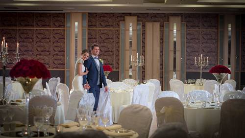 Bride & Groom Walking Through Ballroom in Shearwater Hotel Athlone - Hotel Wedding Photography © David Cantwell Photography
