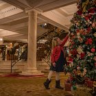 Girl @ Christmas Tree in Hotel Lobby  - Seasonal Commercial Photography © David Cantwell Photography