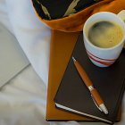 Coffee Mug with Pen, Notebook and Laptop on Bed - Corporate Photographer © David Cantwell Photography