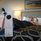 Corporate Businessman on Bed With Do Not Disturb Sign - Commercial Photographer  © David Cantwell Photography