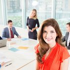 Business People in Meeting Room With Business Woman Smiling at Camera  © David Cantwell Photography
