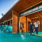 Instructor Giging a Golg Lesson on a Driving Range - Lifestyle Photography © David Cantwell Photography