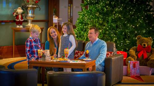 Family Having Christmas Treats in The Lobby of Shearwater Hotel @ Christmas © David Cantwell Photography