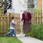 Elderly Lady in the Garden with her Grandchildren © David Cantwell Photography