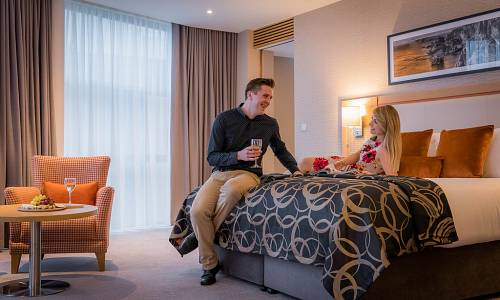Couple in Bedroom - Hotel Photographer © David Cantwell Photography