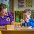 Montessori Teacher with Boy © David Cantwell Photography