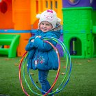Child in Creche Outdoor Play Area © David Cantwell Photography