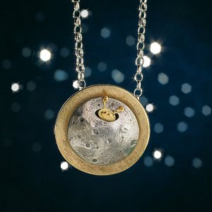 Jewellery photography of a pendant of an alien on the moon