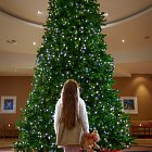 Girl @ Christmas Tree in Lobby  - Seasonal Commercial Photography © David Cantwell Photography