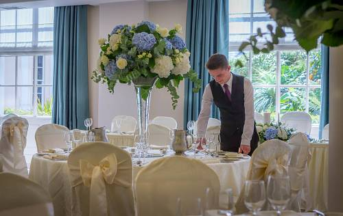 Waiter in Ballroom in Portmarnock Hotel - Hotel Wedding Photography © David Cantwell Photography