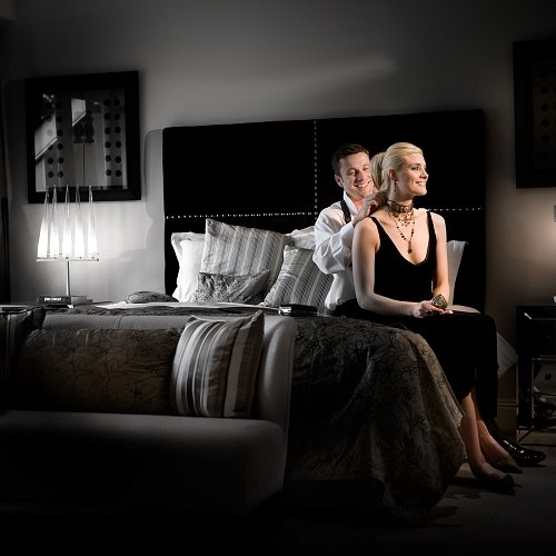 Couple in Double Bedroom Hotel Photographer © David Cantwell Photography